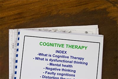 Cognitive therapy concept- with contents on a coversheet workshop