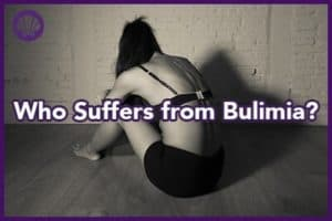 very thin, young woman suffering from bulimia is sitting in fetal position on the floor