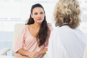 Woman meeting with doctor